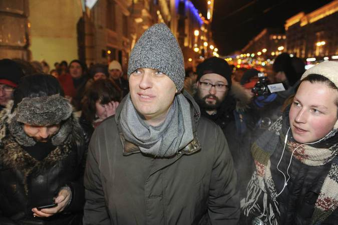 Alexei Navalny, Russian opposition leader and anti-corruption blogger, walks to attend an opposition rally in Moscow