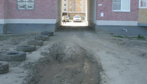 Асфальт под аркой на Северо-Западной, 14 появится к осени