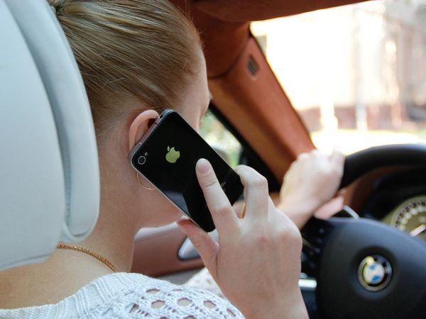 С телефоном за рулем